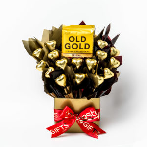 A 200g block of Old Gold dark chocolate and 16 gold foil wrapped dark chocolate hearts surrounded by gold and brown cello in a small gold box.