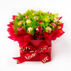 "19 red and gold foil wrapped milk chocolate stars, ""leafed"" in green, surrounded by red cello in a small red box."