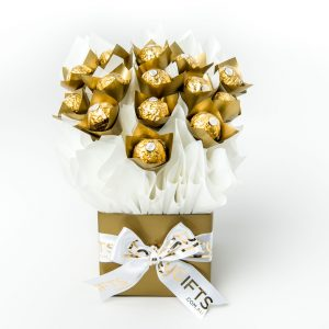 "14 Ferrero Rocher chocolates wrapped in clear and ""leafed"" with gold cello, all elegantly surrounded in white cello in a small gold box."
