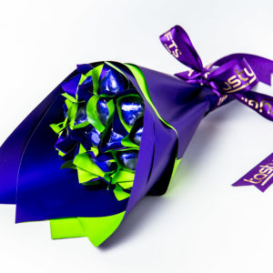 17 purple foil wrapped milk chocolate hearts. All wrapped up in a duo green/purple cello and finished with a purple ribbon with gold print.