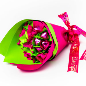 17 pink foil wrapped milk chocolate hearts. All wrapped up in duo pink/green cello and finished with a pink ribbon with gold print.