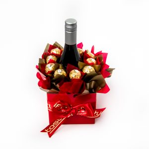 10 Ferrero Rocher chocolates around a 750ml bottle of Stony Peak Shiraz Cabernet red wine in a small red box